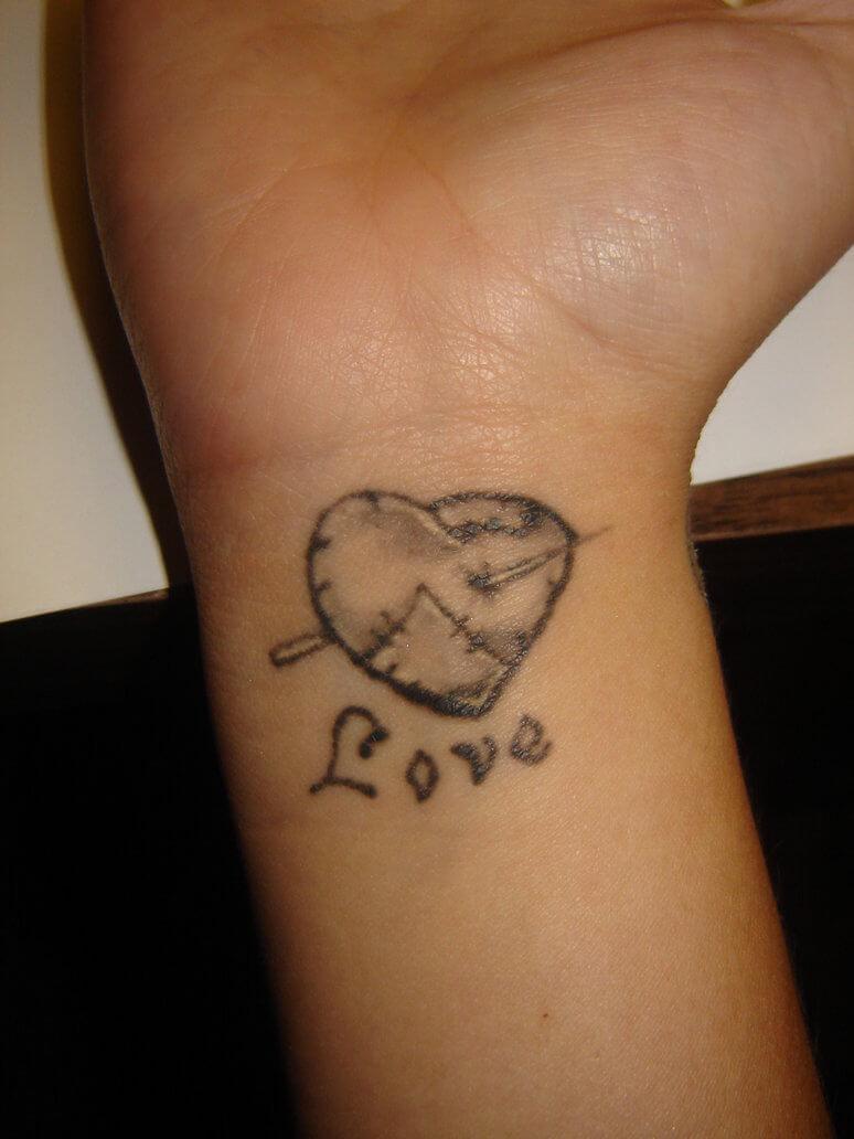 broken heart tattoo on wrist