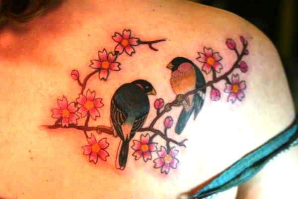 lovebirds tattoo on pink flower tree branch