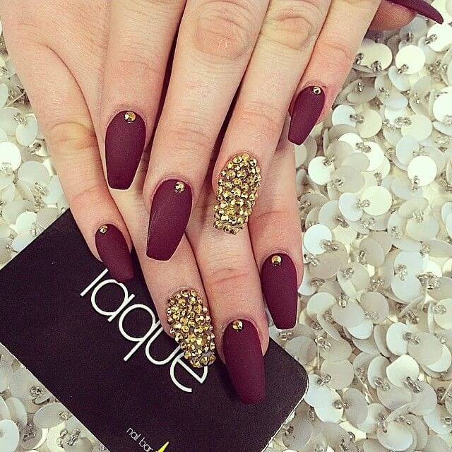 burgundy nails with golden pearls