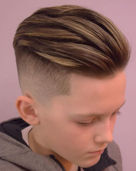 faded back combed haircut for small boys