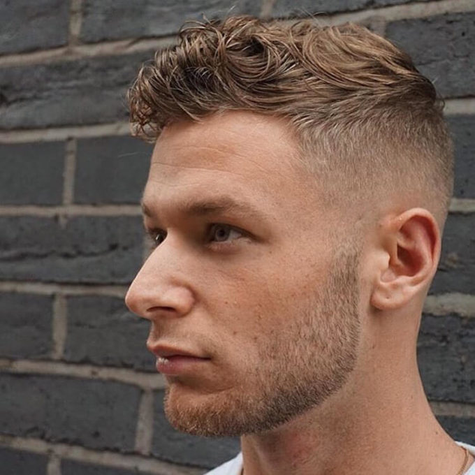 high fade short wavy haircut for men