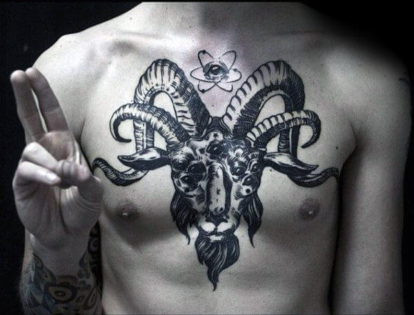 double horned goat tattoo on chest