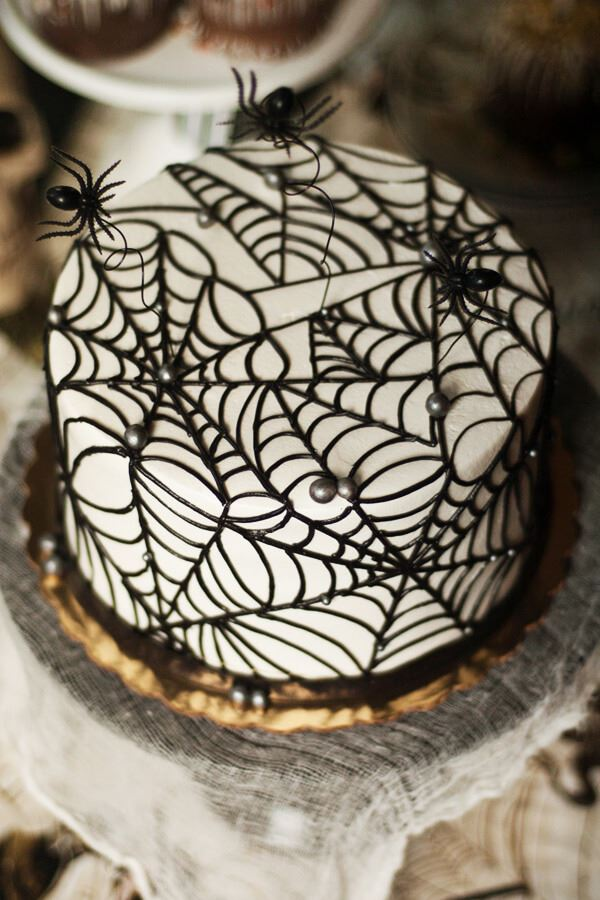 spider webbed with tiny spiders halloween wedding cake