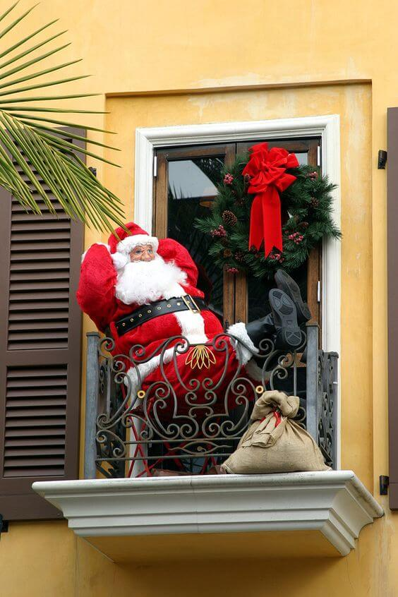 apartment balcony christmas decor with santa claus