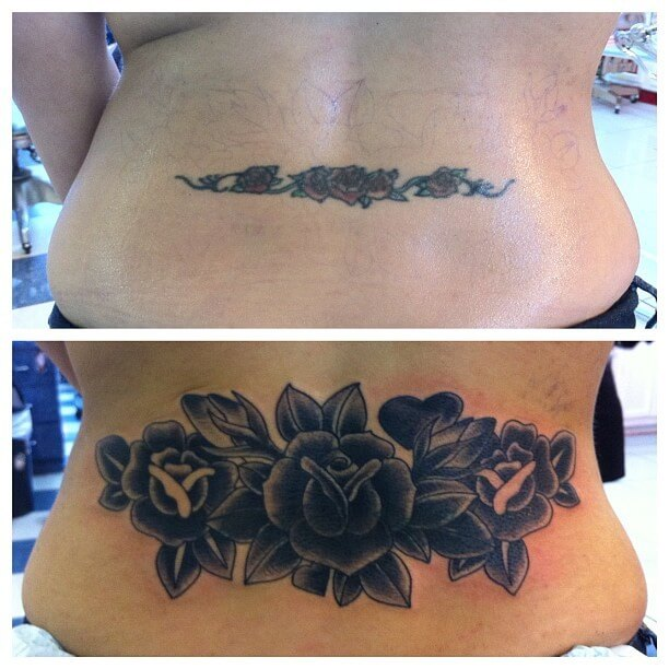 lower back cover up black flowers tattoo design
